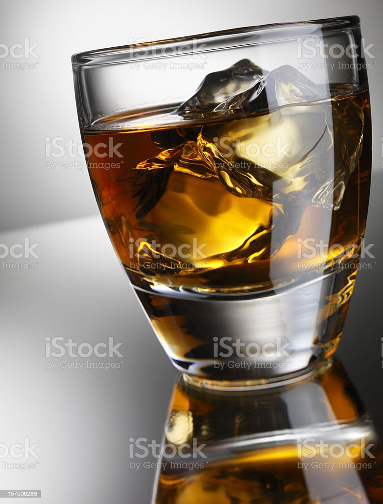 Single Whiskey Glass with reflection, Low Angle stock photo