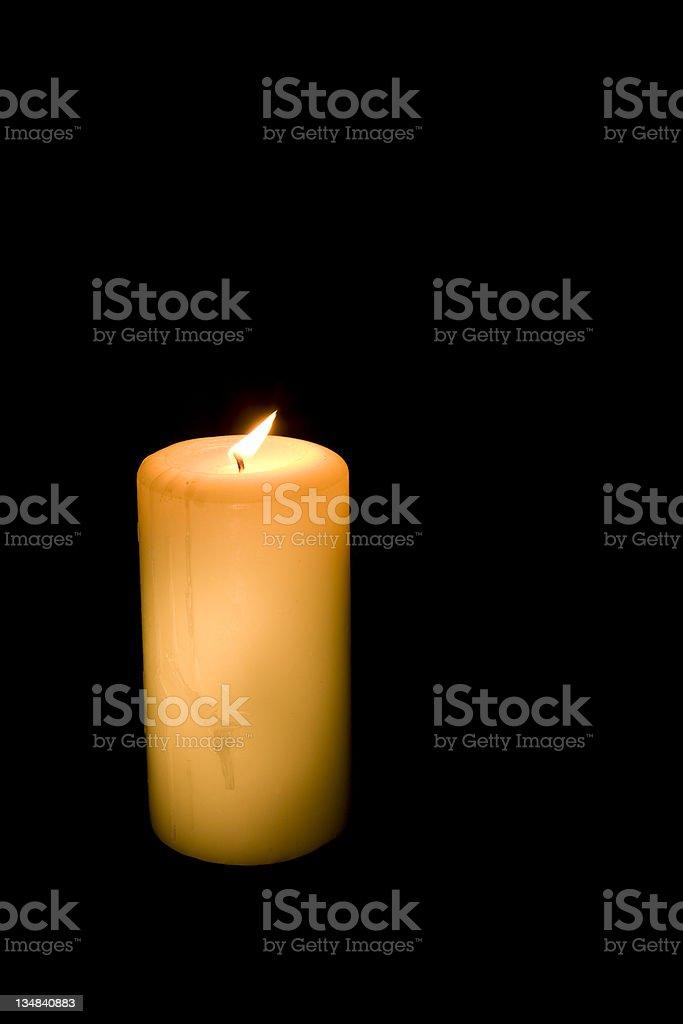 Single white candle on black background royalty-free stock photo