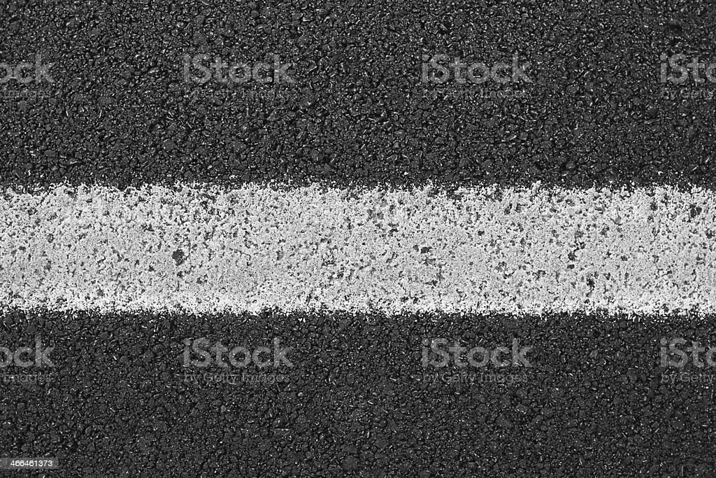 Single white line on asphalt road stock photo