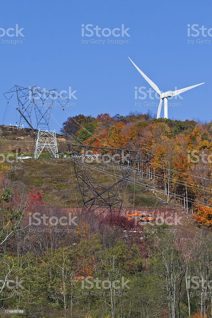 Single Wind Turbine and Electric Grid Under Construction royalty-free stock photo