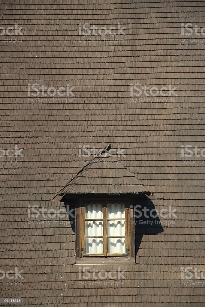 Single window on wooden tiled roof stock photo