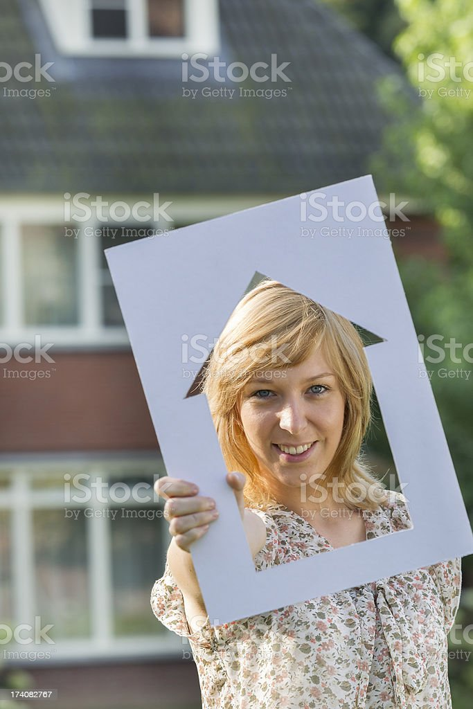 Single woman dreaming about a house stock photo