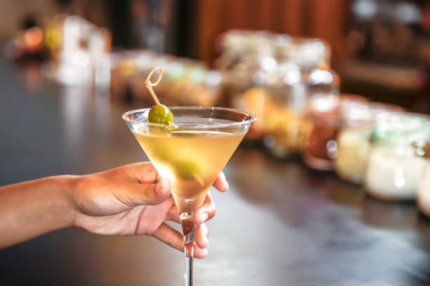Single woman drinking dry martini alone in a bar stock photo