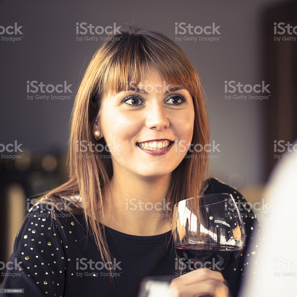 Single woman drinking red wine alone at restaurant royalty-free stock photo