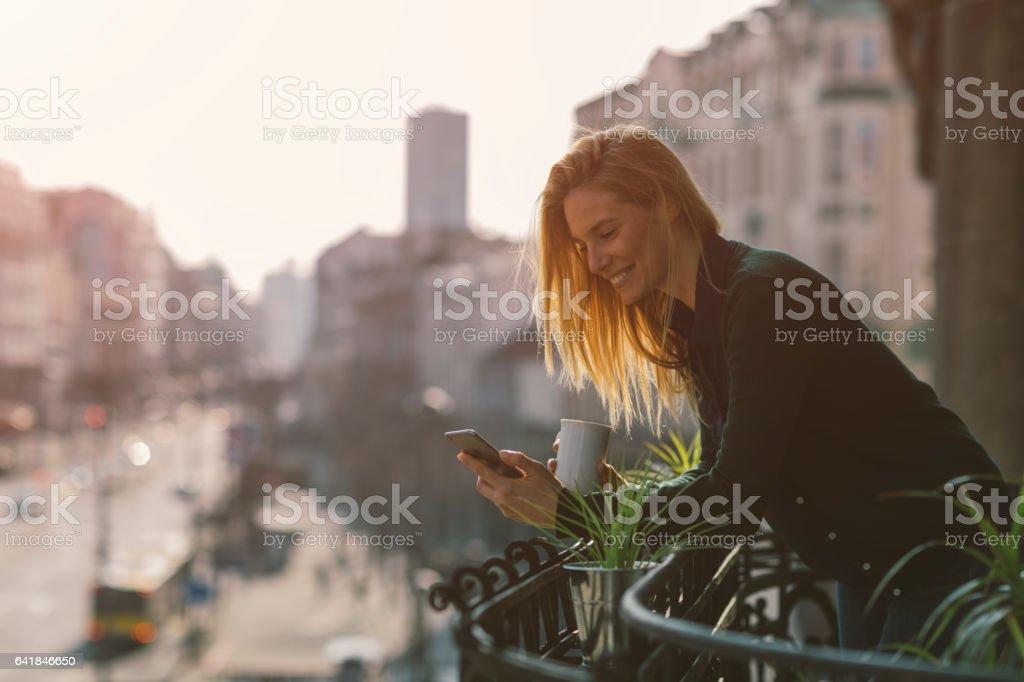 Single woman on hotel balcony stock photo
