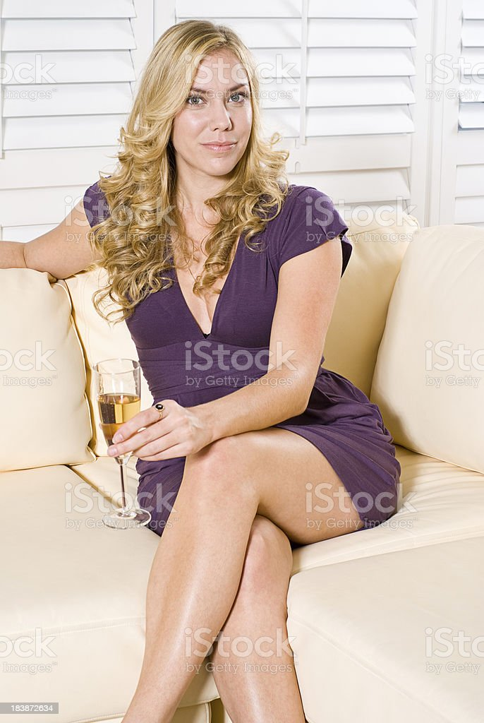 Single Woman Sitting On A Couch Stock Photo