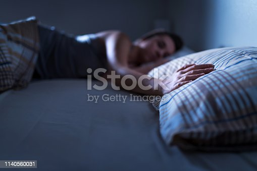 istock Single woman sleeping alone in bed at home. Lonely lady missing husband or boyfriend. Hand on pillow. Solitude, infidelity or heartbreak concept. Loneliness and sorrow after break up. 1140560031