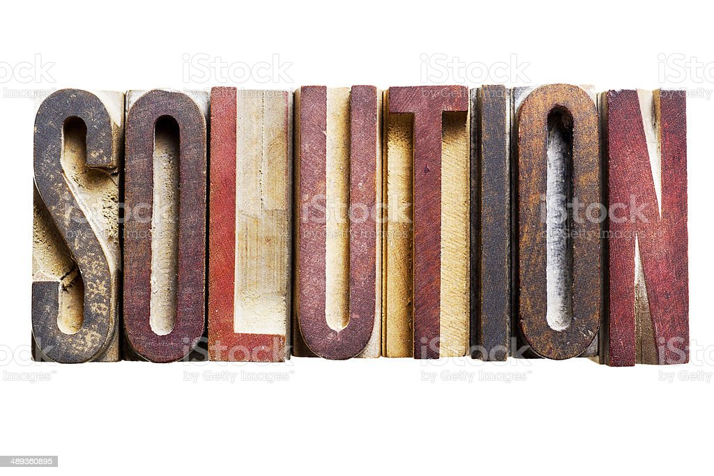 SOLUTION single word old letterpress printing blocks stock photo