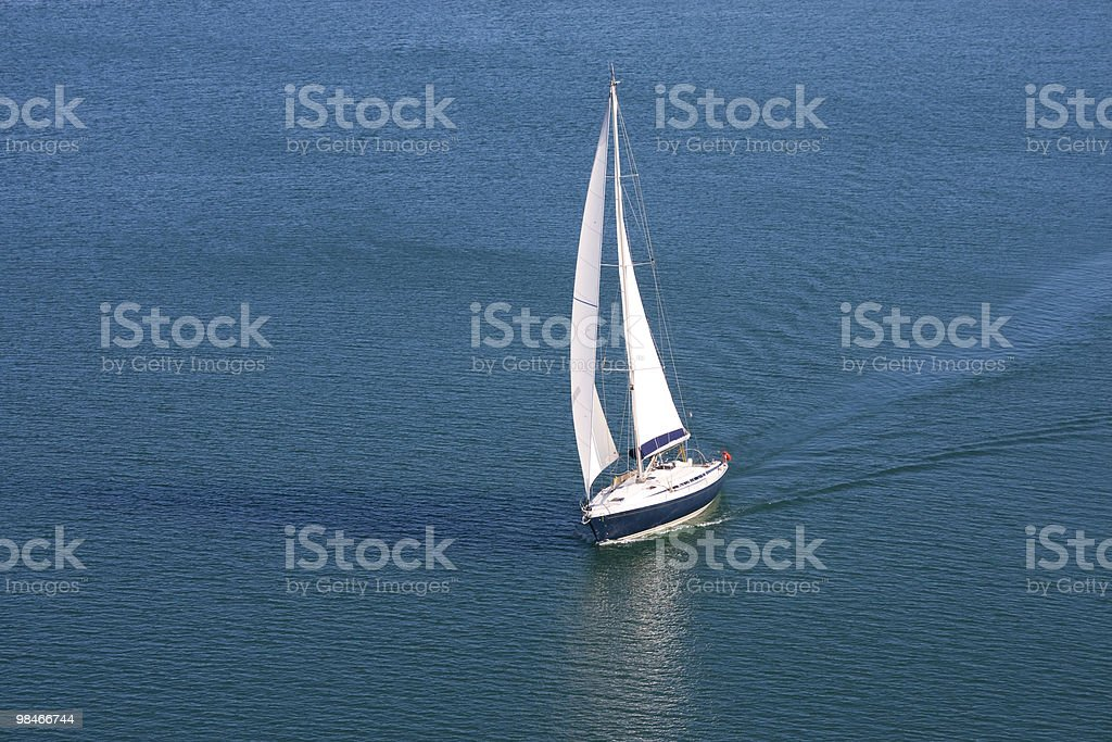Single yacht on blue sea royalty-free stock photo