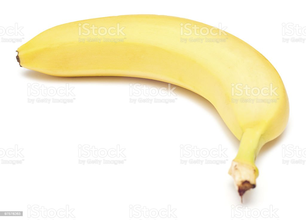 A single, yellow banana on a white background royalty-free stock photo