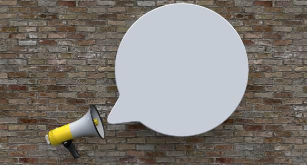 Single Yellow Electric Megaphone On Brick Background stock photo