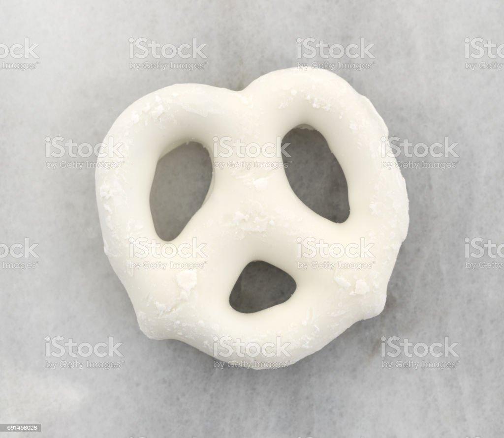 Single yogurt pretzel on a marble cutting board stock photo