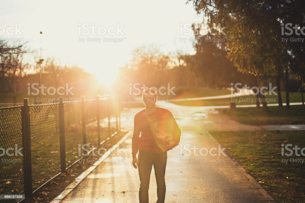 Single young man returning home stock photo
