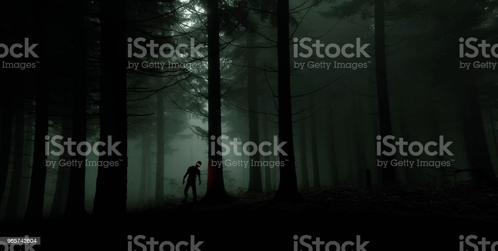 single zombie with red shining eyes in green forest - Royalty-free Ao Ar Livre Foto de stock