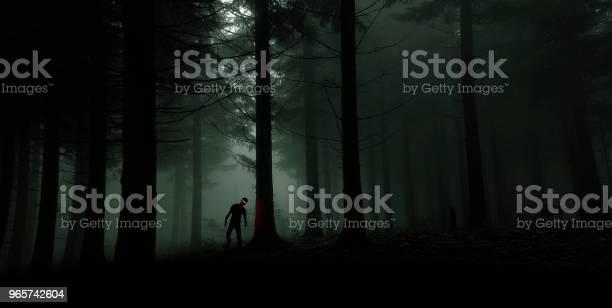 Single Zombie With Red Shining Eyes In Green Forest - Fotografias de stock e mais imagens de Ao Ar Livre