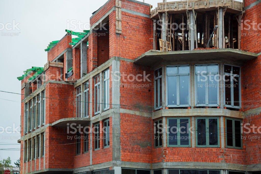 Single-family brick house under construction stock photo