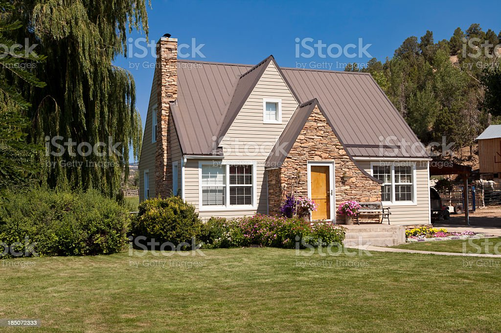 Single-family house with green lawn and trees stock photo