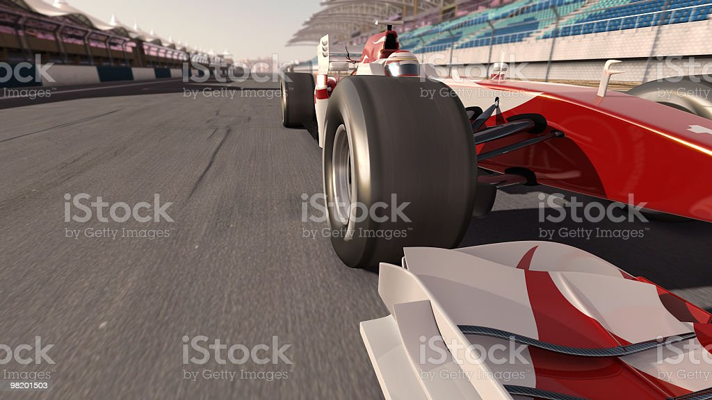 A formula one race car going along a track  stock photo
