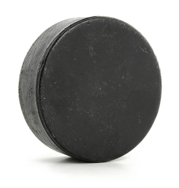 a singular hockey puck on white - hockey puck stock photos and pictures