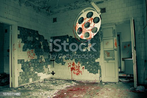 istock Sinister and creepy abandoned operating room in the hospital 1070271480