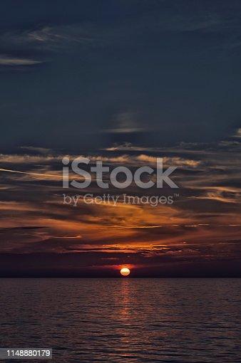 istock Sinister sunset over sea 1148880179