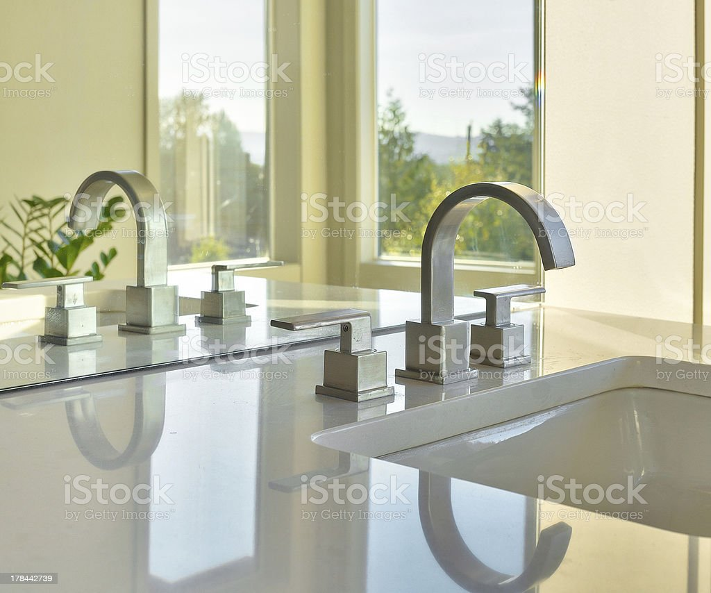 Sink and Reflection in Luxury Home stock photo