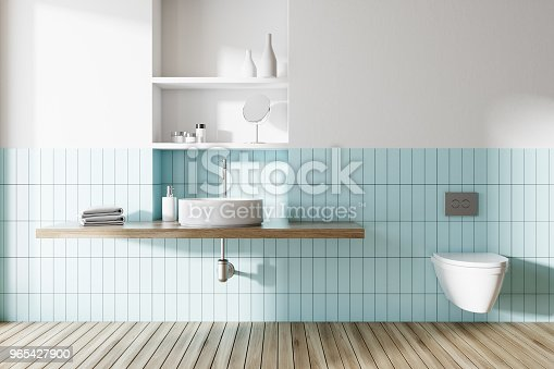Sink And Toilet In A Blue And White Bathroom Stock Photo & More Pictures of Apartment