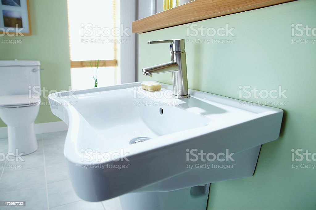 Sink in contemporary home bathroom stock photo