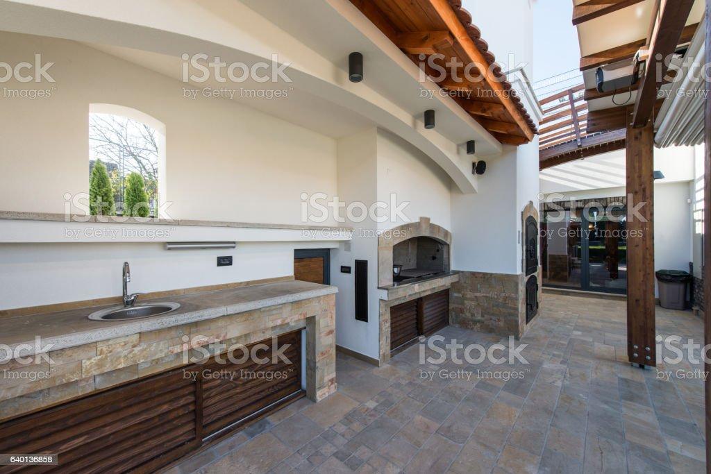Sink in modern outdoor kitchen stock photo