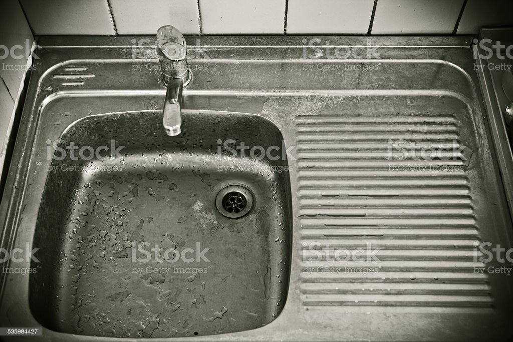 Sink in the kitchen of economy class stock photo