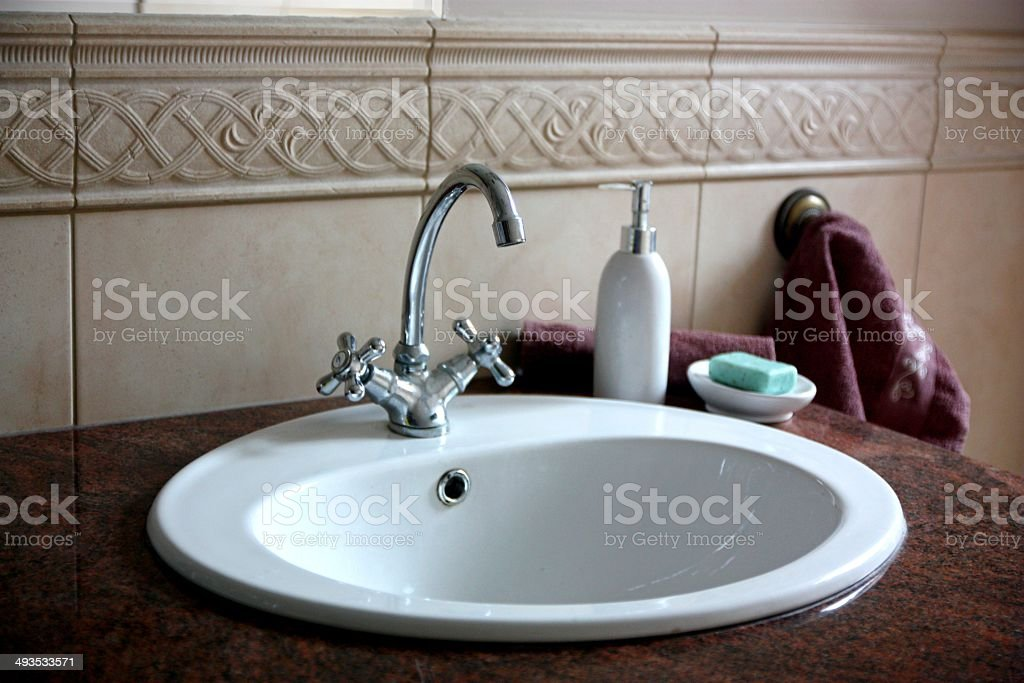 Sink in the marble countertop stock photo