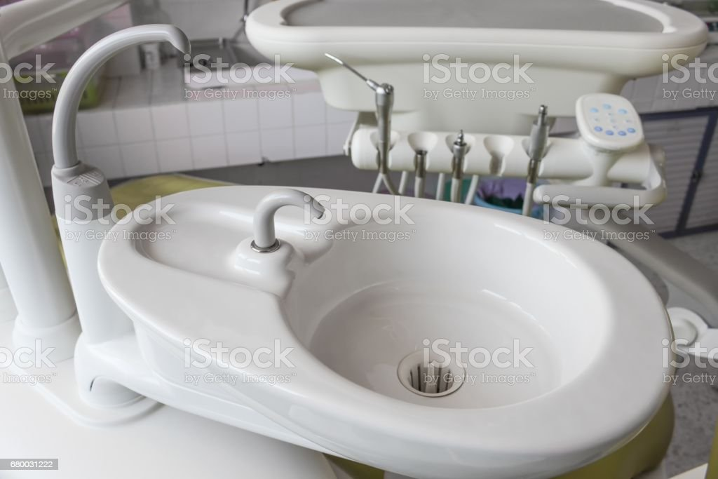 Sink  medical equipment dentist Close up, ceramic spittoon and water filler in Clinic stock photo