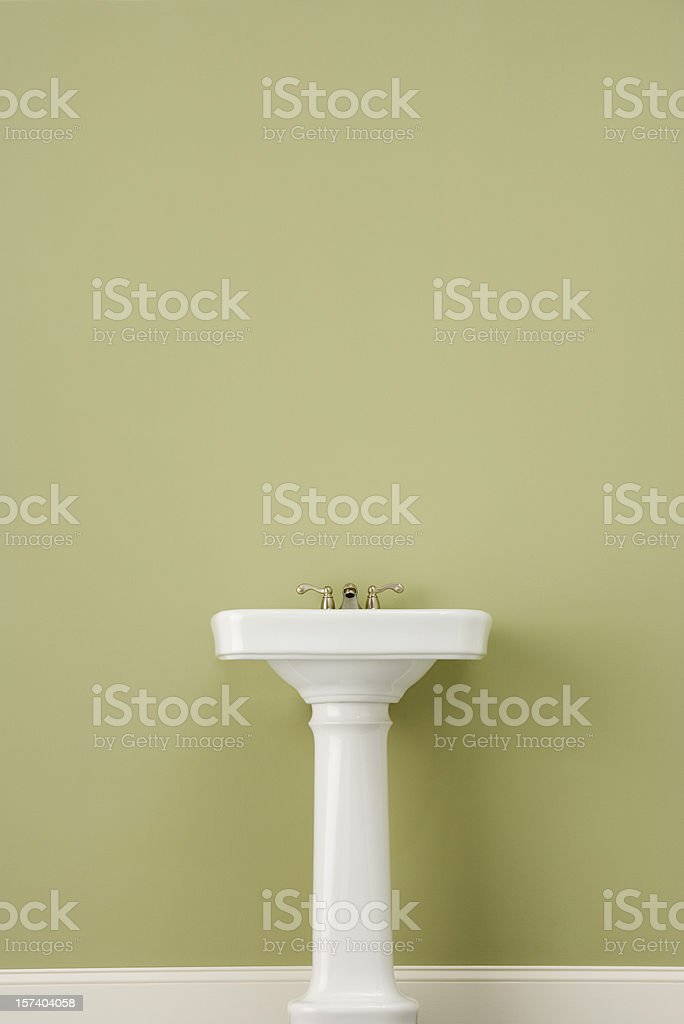 Sink on Green Wall stock photo