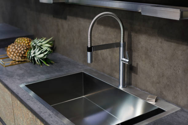 Sink with a tap on a kitchen counter picture id932043860?b=1&k=6&m=932043860&s=612x612&w=0&h=fdszg981jze 3qnwv9twdgahoemu3dxmkjtvom3drai=