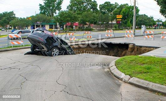 istock Sinkhole Swallows a Car in Florida 695666808