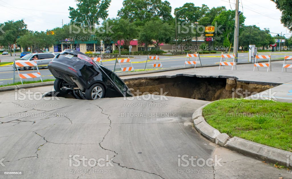 Sinkhole Swallows a Car in Florida stock photo