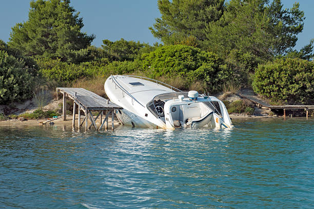 Sinking Boat Speedboat beached and almost sunk at it's mooring sunken stock pictures, royalty-free photos & images