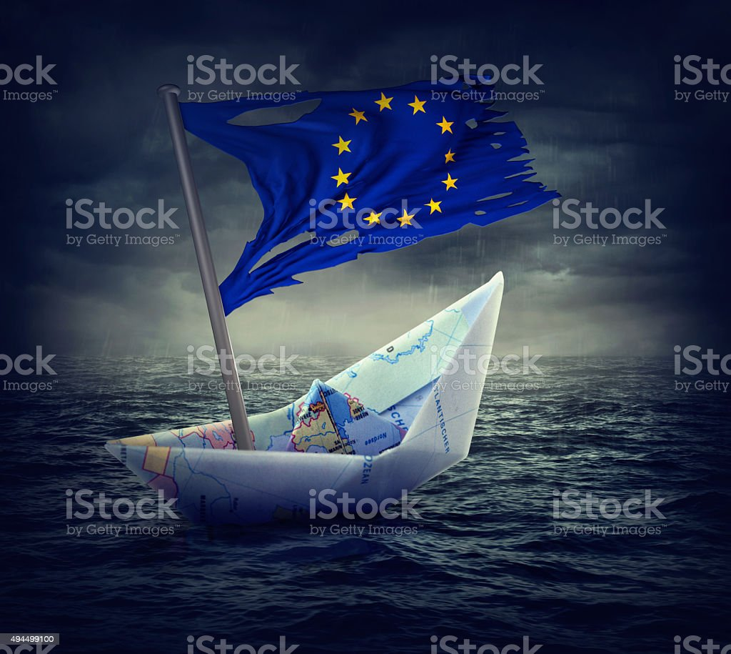 Sinking euro ship with a torn flag stock photo
