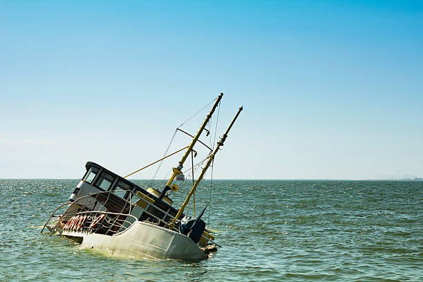 Sinking Ship Passenger boat sinking sunken stock pictures, royalty-free photos & images
