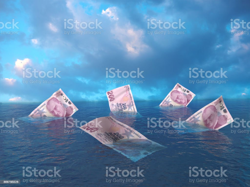 Sinking Turkish Liras stock photo