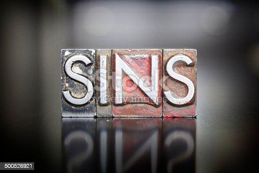 The word SINS written in vintage letterpress lead type