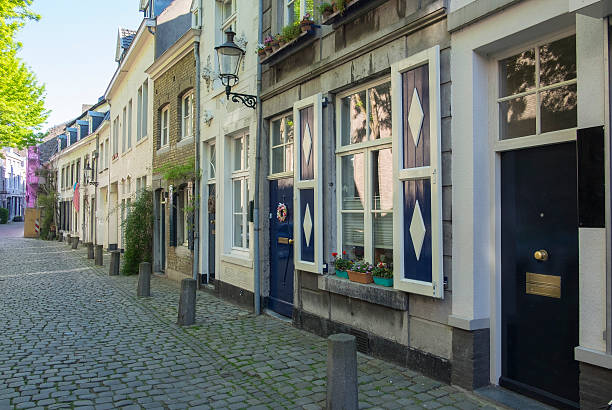 sint bernardusstreet during early morning in maastricht - maastricht stockfoto's en -beelden