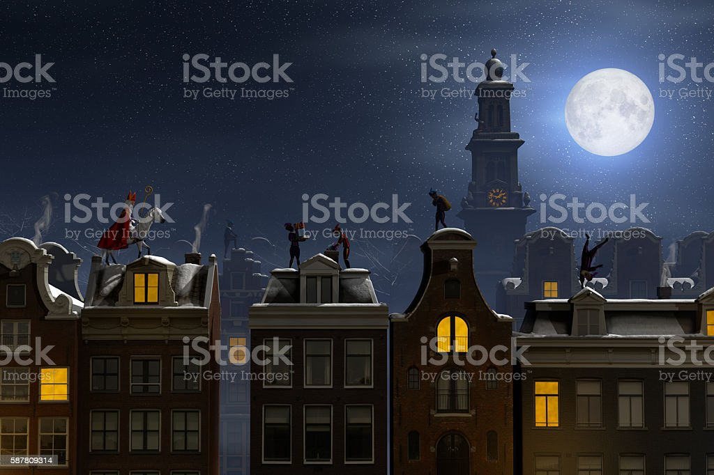 Sinterklaas and the Pieten on the rooftops at night stock photo