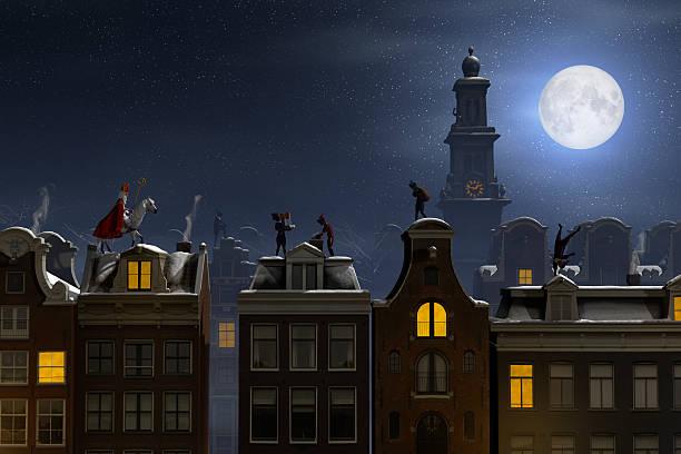 sinterklaas and the pieten on the rooftops at night - saint nicolas photos et images de collection