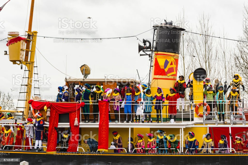 Sinterklaas arriving by steam ship with his Piet Helpers stock photo