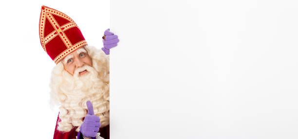 Sinterklaas holding blank cardboard Sinterklaas or saint Nicholas holding blank cardboard. isolated on white background. Dutch character of Santa Claus sinterklaas stock pictures, royalty-free photos & images