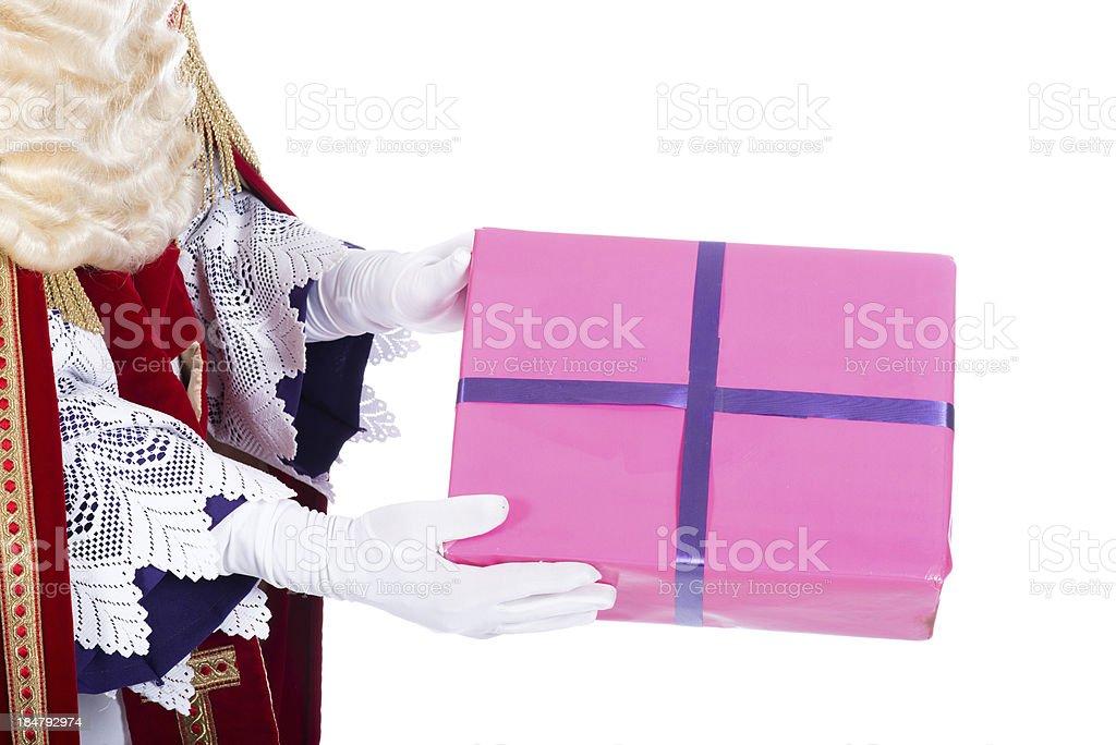 Sinterklaas is giving a present stock photo