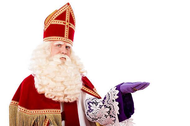 Sinterklaas on white background Sinterklaas portrait. isolated on white background. Dutch character of Santa Claus or St. Nicholas and Black Pete sinterklaas stock pictures, royalty-free photos & images