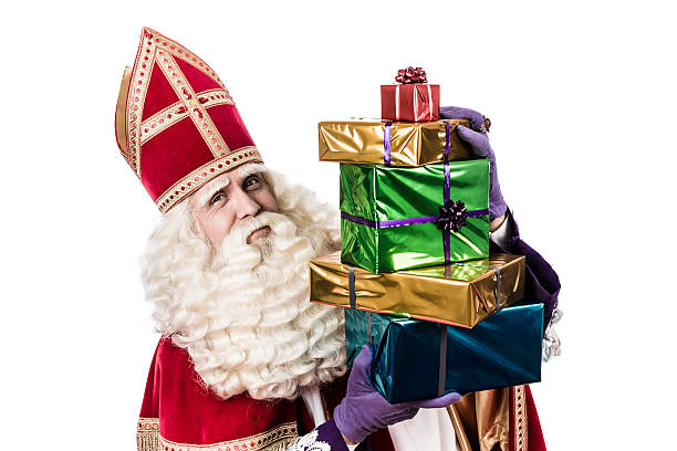 Sinterklaas showing  gifts Sinterklaas with gifts .  Vintage editing. Typical Dutch characterof st. Nicholas and Zwarte Piet sinterklaas stock pictures, royalty-free photos & images