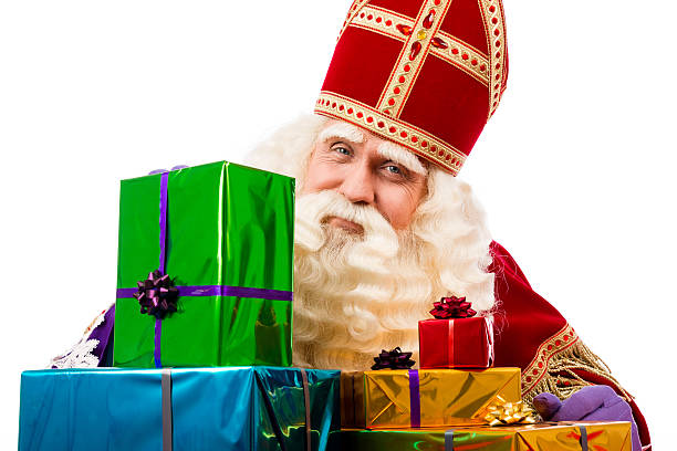 Sinterklaas showing  gifts Sinterklaas with gifts . typical Dutch characterof st.Nicholas and Zwarte Piet sinterklaas stock pictures, royalty-free photos & images